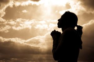 woman praying silhoutte